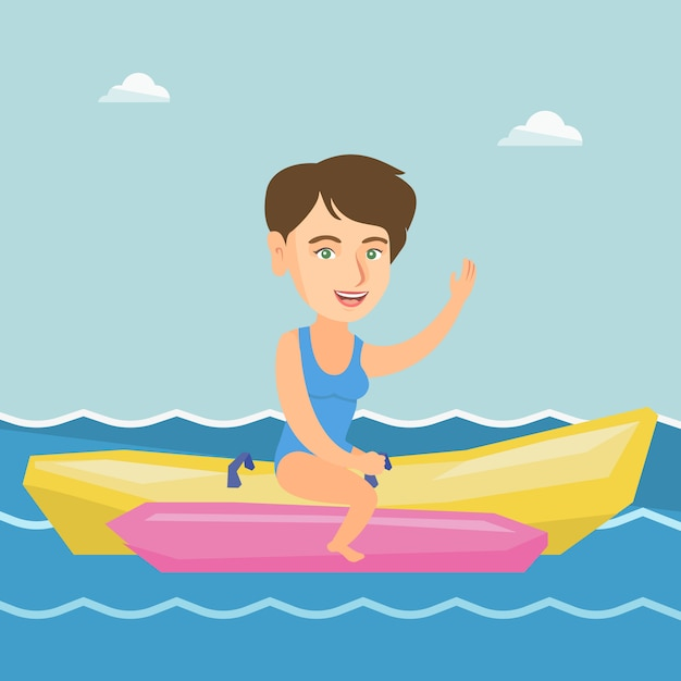 Young happy caucasian woman riding a banana boat. Premium Vector