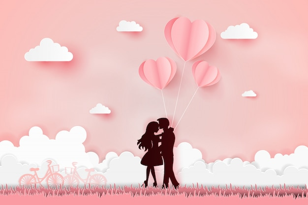 Young joyful couple on field Premium Vector