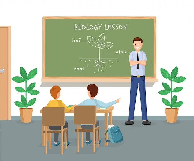 Young male teacher explaining plant structure at chalkboard Premium Vector