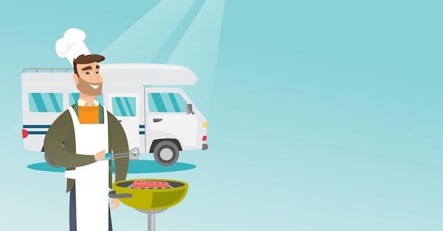 Young man barbecuing meat in front of camper van. Premium Vector