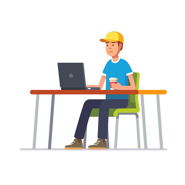 Young man in cap working at his clean office desk Free Vector