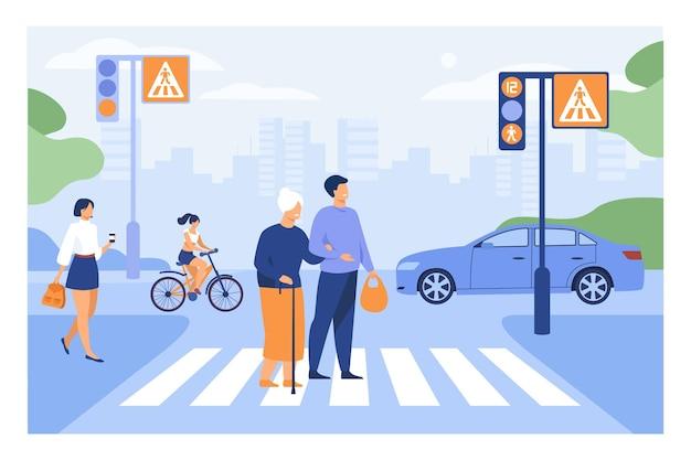Giovane che aiuta l'anziana donna che attraversa l'illustrazione piana della strada. attraversamento pedonale della città a piedi anziani del fumetto con l'aiuto del ragazzo Vettore gratuito