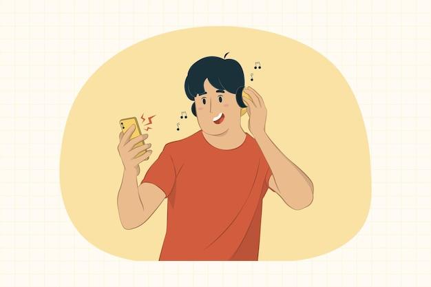 젊은 남자 스마트 폰 들고 헤드폰 개념으로 듣는 음악 프리미엄 벡터