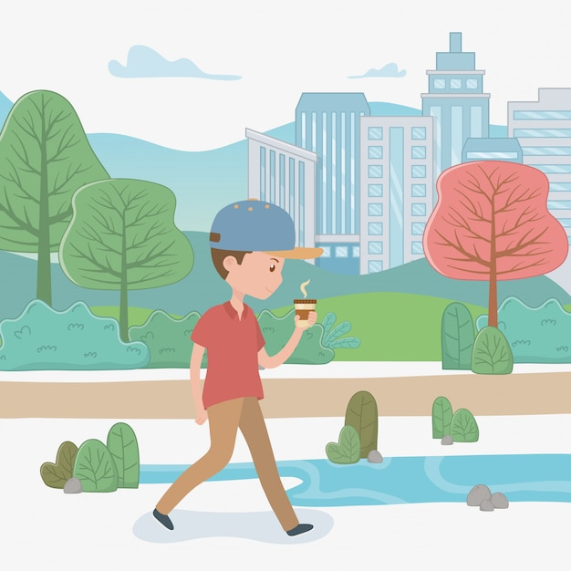 Young man walking with coffee in the park Free Vector