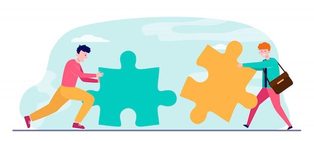 Giovani con grandi pezzi del puzzle Vettore gratuito