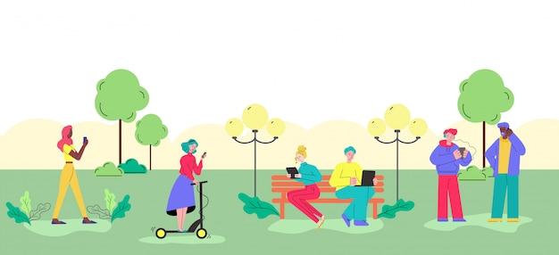 公園でガジェットを使用している若者 Premiumベクター