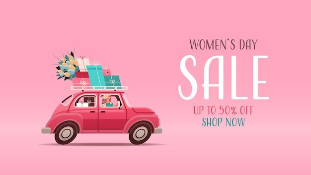 Молодая женщина за рулем автомобиля с подарками и цветами женский день 8 марта праздник покупки распродажа концепция надписи поздравительная открытка горизонтальная иллюстрация Premium векторы