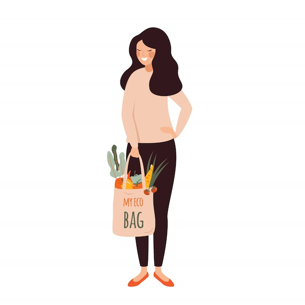 Young woman holds eco cotton bag full of fresh vegetables in her hands .vector Premium Vector