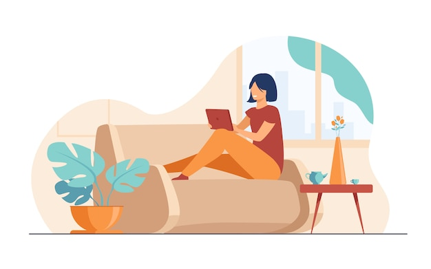 Young woman relaxing at sofa with laptop Free Vector
