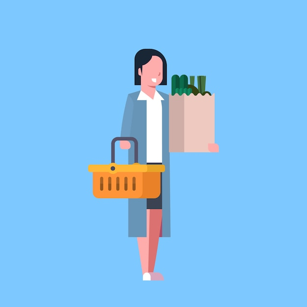 Young woman shopping holding paper bag and basket full of grocery products Premium Vector