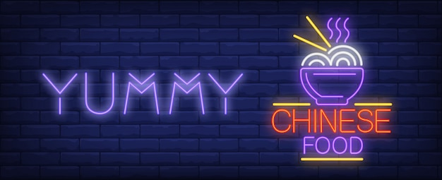 Yummi chinese food neon sign. bowl of ramen and bright inscription. Free Vector
