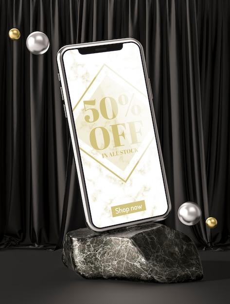 3d-modell-smartphone auf marmorfelsen Kostenlosen PSD