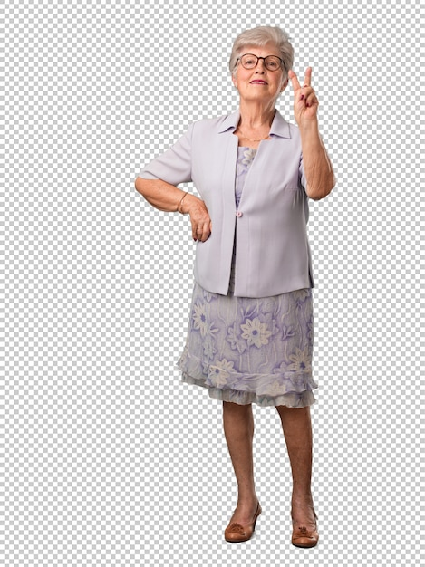 Ältere frau des vollen körpers, die nummer zwei, symbol der zählung, konzept von mathematik zeigt, überzeugt und nett Premium PSD