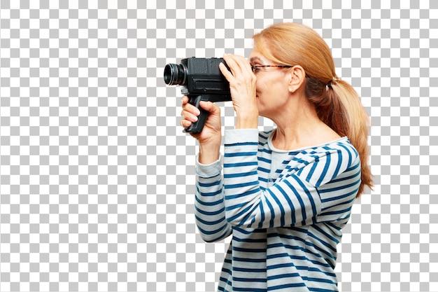 Ältere schöne frau mit einer weinlesekino-kamera Premium PSD