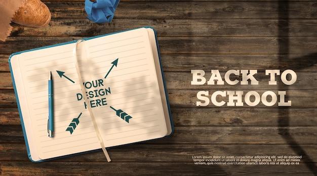 Back to school mockup notebook auf dunklen holztischfenster schatten Premium PSD
