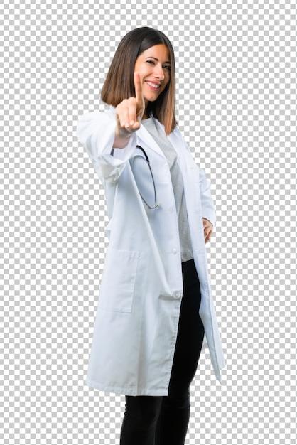 Behandeln sie frau mit dem stethoskop, das einen finger im zeichen des besten zeigt und anhebt Premium PSD