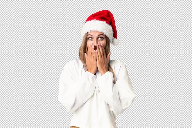 Blondes mädchen mit weihnachtshut mit überraschungsgesichtsausdruck Premium PSD