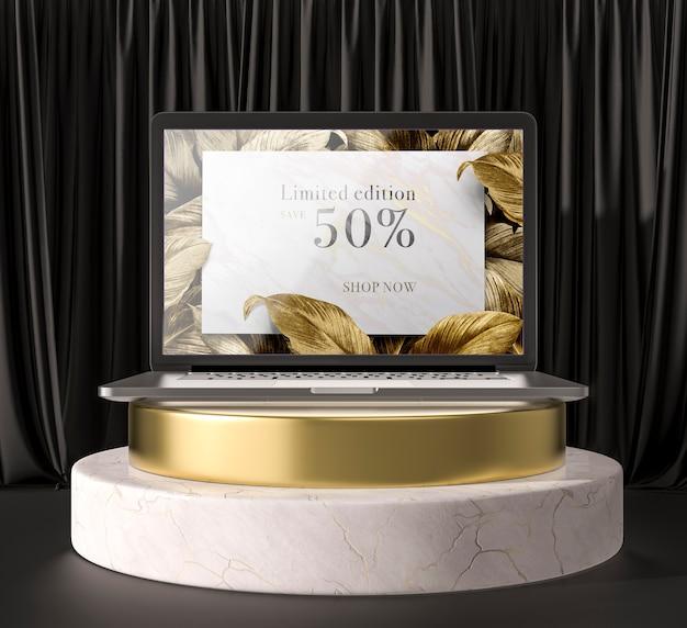 Digitales tablet mit goldenen blättern auf einem halter Kostenlosen PSD