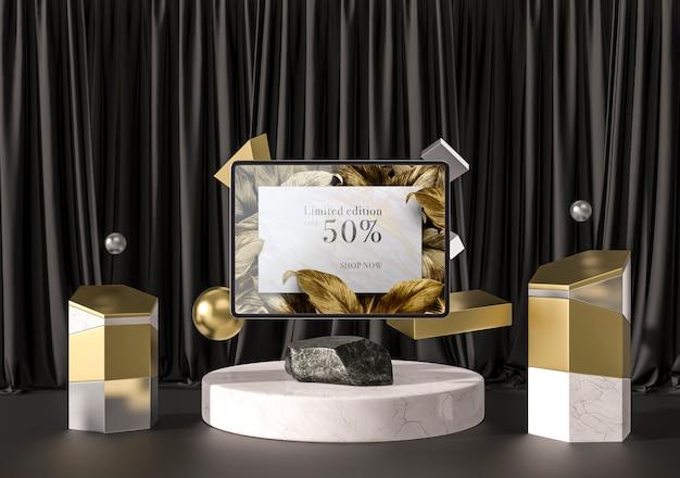 Digitales tablet mit goldenen blättern und geometrischen formen Kostenlosen PSD