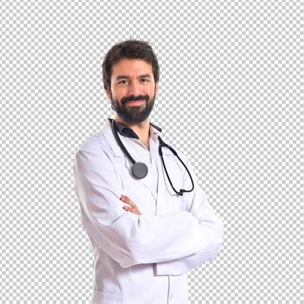 Doktor mit seinen armen kreuzte über weißem hintergrund Premium PSD