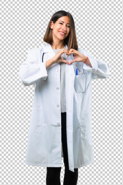 Doktorfrau mit dem stethoskop, das ein herz mit seinen händen macht Premium PSD