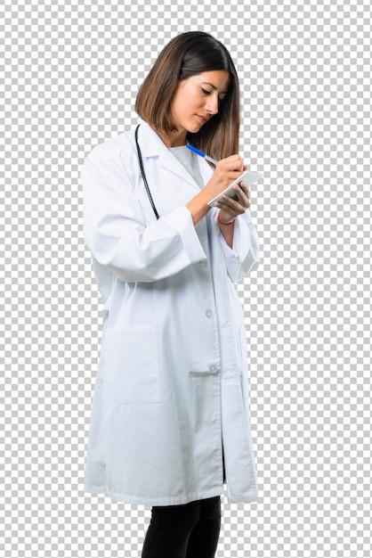 Doktorfrau mit dem stethoskop, das ein notizbuch hält Premium PSD