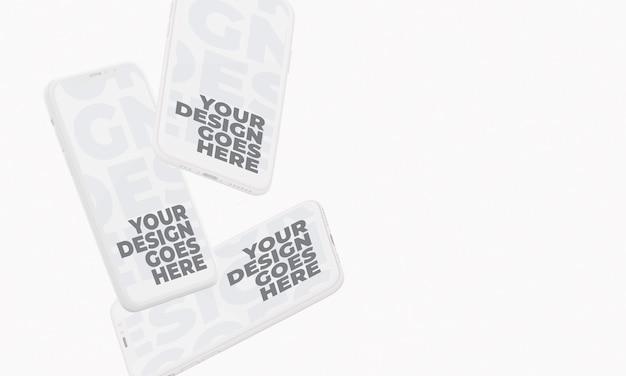 Drei schwimmende smartphones white clay style Premium PSD
