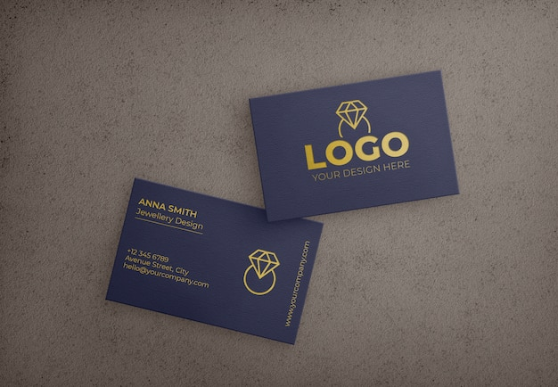 Dunkelblaue geschäftskarte mit goldenem design Kostenlosen PSD