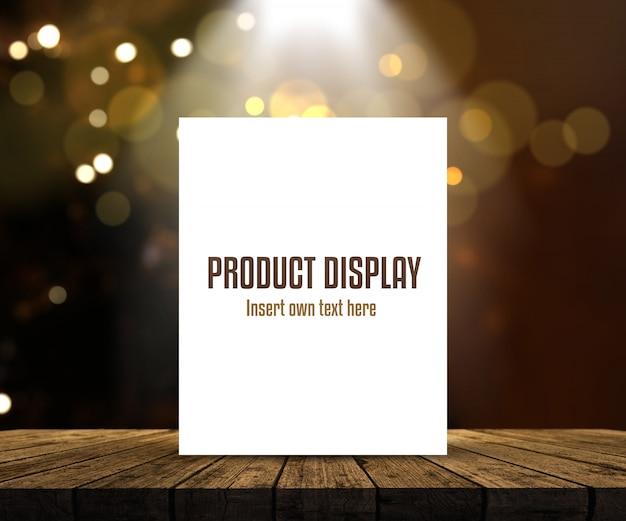 Editable produktanzeigenhintergrund mit leerem bild auf holztisch gegen bokeh beleuchtet Kostenlosen PSD