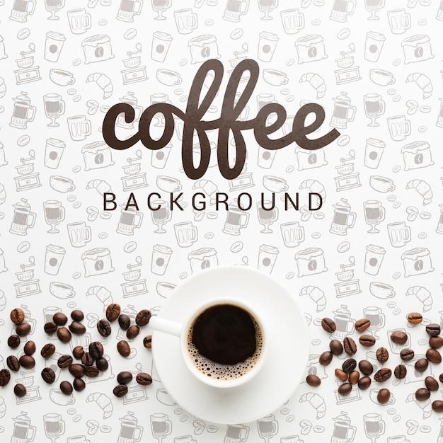Eleganter hintergrund mit geschmackvoller kaffeetasse Kostenlosen PSD