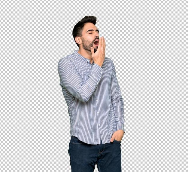 Eleganter mann mit dem gähnenden hemd und weitem offenem mund mit der hand bedeckend Premium PSD