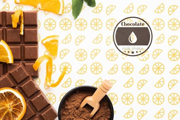 Flache laienschokolade mit orangefarbenem hintergrundmodell Kostenlosen PSD