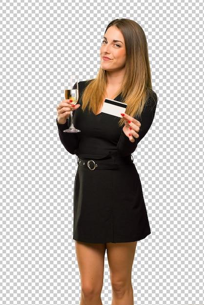 Frau mit dem champagner, der das neue jahr 2019 feiert, eine kreditkarte anhalten Premium PSD