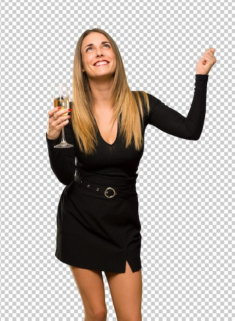 Frau mit dem champagner, der das neue jahr 2019 feiert, einen sieg in der siegerposition feiernd Premium PSD