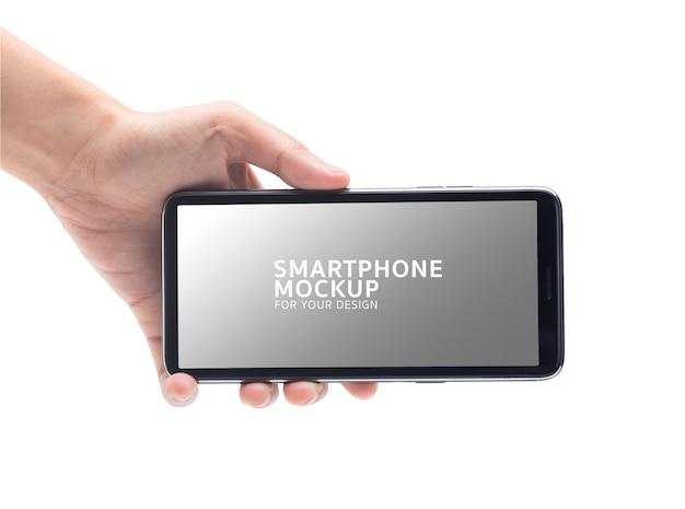 Frauenhand, die das schwarze smartphonemodell für ihr design hält. Premium PSD