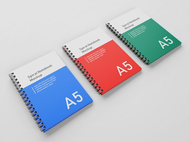 Gebrauchsfertig drei corporate hardcover spiral a5 binder notebook mock-up-design-vorlage in perspective view Premium PSD