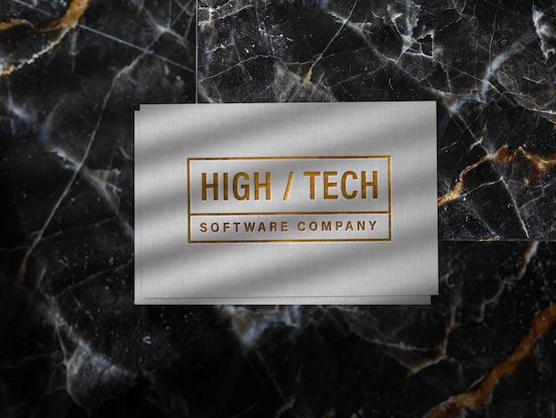 Geprägtes goldenes logo-modell auf leinenpapier Kostenlosen PSD