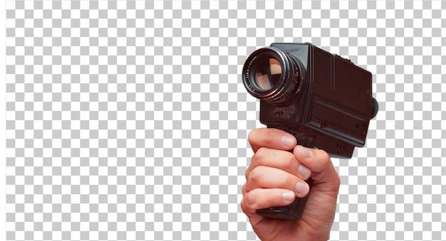 Getrennte männliche hand, die eine super 8 weinlesekamera anhält Premium PSD