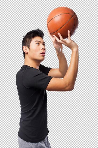 Glücklicher chinesischer sportmann mit korbball Premium PSD