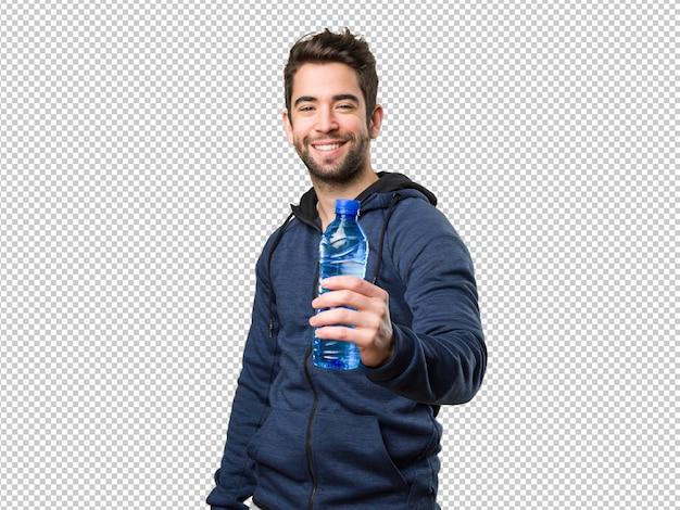 Glücklicher junger mann, der eine flasche wasser hält Premium PSD