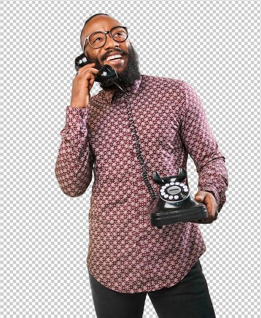 Glücklicher schwarzer mann, der am telefon spricht Premium PSD