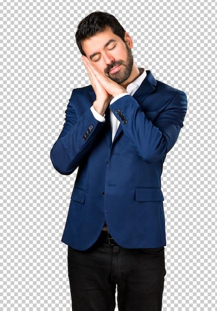 Gut aussehender mann, der schlafgeste macht Premium PSD