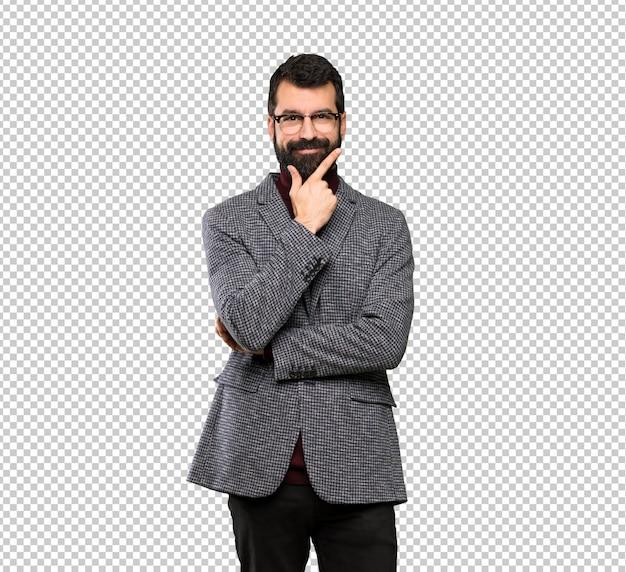 Gut aussehender mann mit brille denken Premium PSD