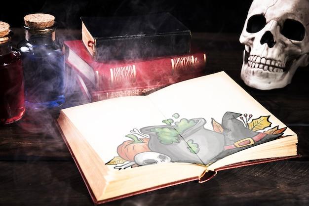 Halloween-schreibtischdekoration mit offenem buch und nebel Kostenlosen PSD