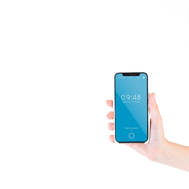 Hand, die smartphonemodell hält Kostenlosen PSD