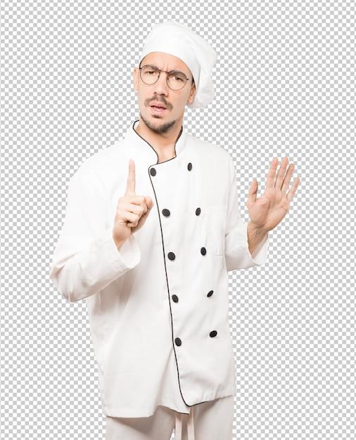 Hochmütiger junger koch, der eine verächtliche geste macht Premium PSD