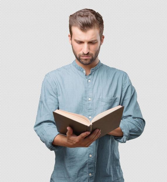 Hübsche lesung des jungen mannes im buch Premium PSD