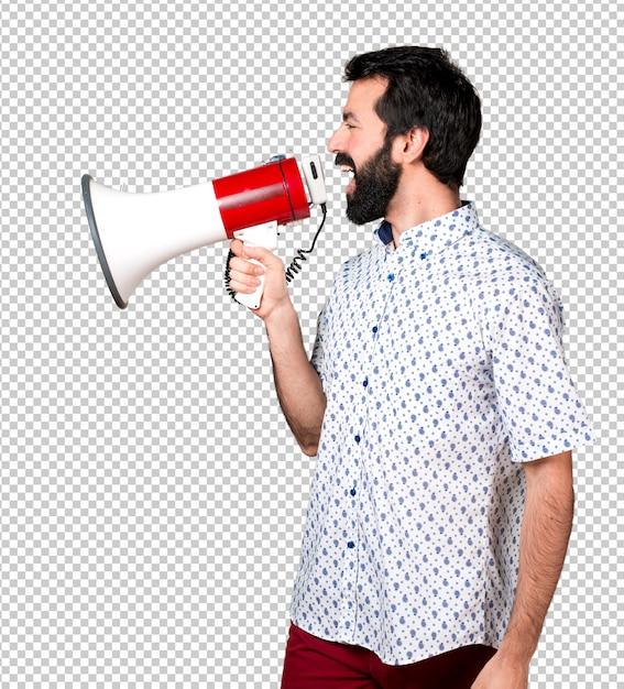 Hübscher brunettemann mit bart schreiend durch megaphon Premium PSD