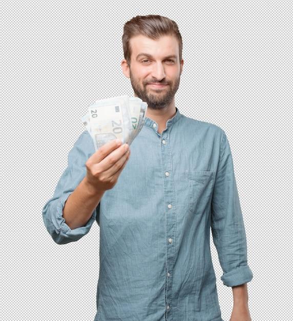 Hübscher junger mann mit geld in der hand Premium PSD