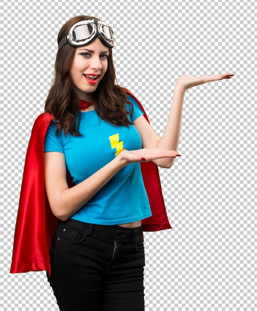 Hübsches superheldmädchen, das etwas darstellt Premium PSD